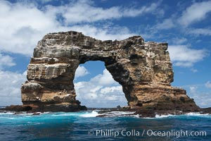 Darwins Arch, a dramatic 50-foot tall natural lava arch, rises above the ocean a short distance offshore of Darwin Island. Darwin Island, Galapagos Islands, Ecuador, natural history stock photograph, photo id 16621