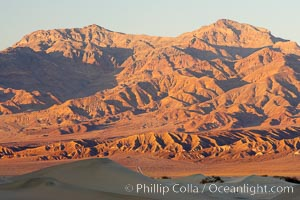 Grapevine Mountain Range, with sand dunes in the foreground.  Sunset, Stovepipe Wells, Death Valley National Park, California