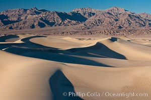 Sand Dunes and the Grapevine Mountains, California.  Near Stovepipe Wells lies a region of sand dunes, some of them hundreds of feet tall. Death Valley National Park, USA, natural history stock photograph, photo id 15639