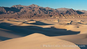 Sand Dunes and the Grapevine Mountains, California.  Near Stovepipe Wells lies a region of sand dunes, some of them hundreds of feet tall. Death Valley National Park, USA, natural history stock photograph, photo id 15642