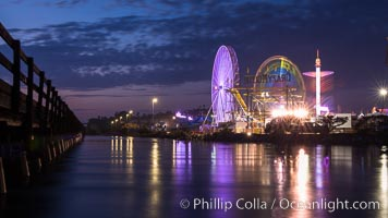 Del Mar Fair and San Dieguito Lagoon at Night.  Lights from the San Diego Fair reflect in San Dieguito Lagooon, with the train track trestles to the left. California, USA, natural history stock photograph, photo id 31023