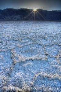 Devils Golf Course. Evaporated salt has formed into gnarled, complex crystalline shapes on the salt pan of Death Valley National Park, one of the largest salt pans in the world.  The shapes are constantly evolving as occasional floods submerge the salt concretions before receding and depositing more salt