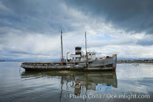 Dilapitated old wooden boat in Ushuaia harbor