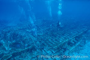 Divers swim over a undersea wreck. Bahamas, natural history stock photograph, photo id 00695