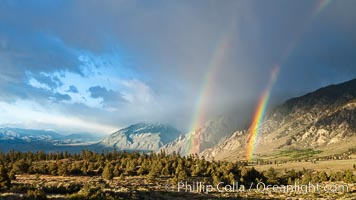 Double rainbow forms in storm clouds, over Swall Meadows and Round Valley in the Eastern Sierra Nevada, Bishop, California