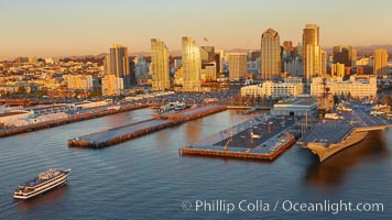Downtown San Diego bayfront, Marina District, with the USS Midway Navy aircraft carrier (right), cruise ship terminal (left) and high rise office buildings towering over North Harbor Drive along San Diego Bay. San Diego, California, USA, natural history stock photograph, photo id 22308