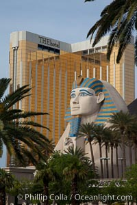 Egyptian Sphinx, replica, front entrance of the Luxor Hotel in Las Vegas, with theHotel (Mandalay Bay hotel) in the background