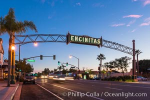 Image 28840, Encinitas city sign lit at night over Highway 101. California, USA, Phillip Colla, all rights reserved worldwide. Keywords: beach, california, coast, coast highway, dusk, encinitas, evening, highway 101, neon, night, san diego, sign, sunset.