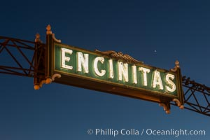 Image 28842, Encinitas city sign lit at night over Highway 101. Encinitas, California, USA, Phillip Colla, all rights reserved worldwide. Keywords: beach, california, coast, coast highway, dusk, encinitas, evening, highway 101, neon, night, san diego, sign, sunset.