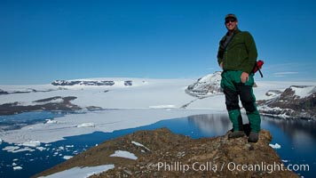 Enjoying a sunny warm day on the summit of Devil Island, with the cliffs of Vega Island in the distance. Antarctic Peninsula, Antarctica, natural history stock photograph, photo id 24817