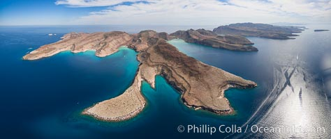 Ensenada Grande, Isla Partida, Sea of Cortez. From left to right: Punta Tintorera, Ensenada Grande, Punta Tijeretas, Las Cuevitas, El Cardonal. Los Islotes visible in distance at upper left