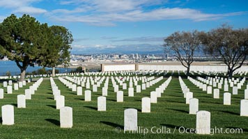 Tombstones at Fort Rosecrans National Cemetery, with downtown San Diego in the distance