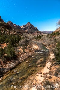 The Watchman and Virgin River under a full moon. The full moon illuminates Zion National Park at night
