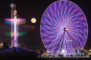Full moon rising at night over the San Diego County Fair.  Del Mar Fair at night