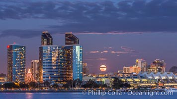 Full moon rising over San Diego city skyline, sunset, storm clouds, viewed from Coronado Island. San Diego, California, USA, natural history stock photograph, photo id 28022