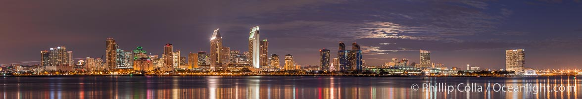 Full moon rising over San Diego city skyline, sunset, storm clouds, viewed from Coronado Island. California, USA, natural history stock photograph, photo id 28024