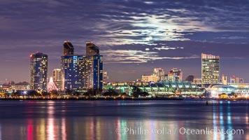 Full moon rising over San Diego city skyline, sunset, storm clouds, viewed from Coronado Island. San Diego, California, USA, natural history stock photograph, photo id 28025