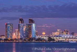 Full moon rising over San Diego city skyline, sunset, storm clouds, viewed from Coronado Island. San Diego, California, USA, natural history stock photograph, photo id 28026