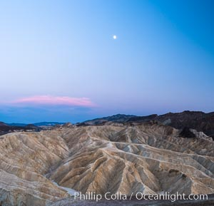 Full moon over Zabriskie Point landscape, Death Valley National Park, California