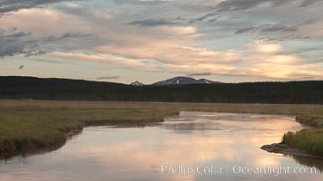 Gibbon River meanders through Gibbon Meadows, sunrise and clouds reflected in the calm waters. Yellowstone National Park, Wyoming, USA, natural history stock photograph, photo id 26946