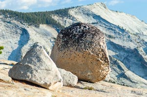 Glacial erratics atop Olmsted Point, with Clouds Rest in the background. Erratics are huge boulders left behind by the passing of glaciers which carved the granite surroundings into their present-day form, Yosemite National Park, California