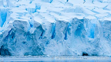 A glacier fractures and cracks, as the leading of a glacier fractures and cracks as it reaches the ocean.  The pieces will float away to become icebergs. Neko Harbor, Antarctic Peninsula, Antarctica, natural history stock photograph, photo id 25741