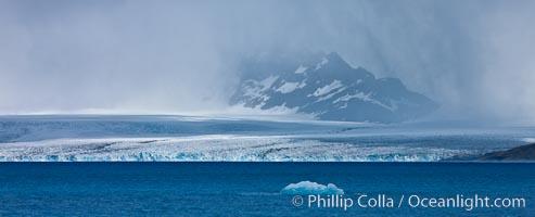 Glacier and iceberg, Cumberland Bay, near Grytviken. Grytviken, South Georgia Island, natural history stock photograph, photo id 24551