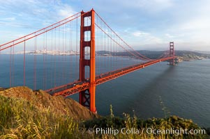 Golden Gate Bridge, viewed from the Marin Headlands with the city of San Francisco in the distance.  Late afternoon