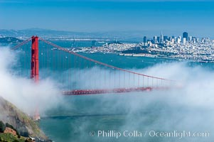San Franciscos infamous summer fog overtakes the Golden Gate Bridge, viewed from the Marin Headlands with the city of San Francisco visible in the distance. San Francisco, California, USA, natural history stock photograph, photo id 09060