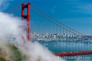 San Franciscos infamous summer fog overtakes the Golden Gate Bridge, viewed from the Marin Headlands with the city of San Francisco visible in the distance. San Francisco, California, USA, natural history stock photograph, photo id 09062