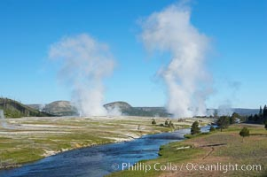 Steam rises above the Midway Geyser Basin, largely from Grand Prismatic Spring and Excelsior Geyser. The Firehole River flows by, Yellowstone National Park, Wyoming