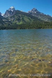 The Teton Range rises above Bradley Lake, Grand Teton National Park, Wyoming