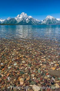 Rocky shallows in Jackson Lake with Mount Moran in the background, Grand Teton National Park, Wyoming