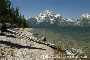 Rocky shoreline of Jackson Lake with Mount Moran in the background, Grand Teton National Park, Wyoming