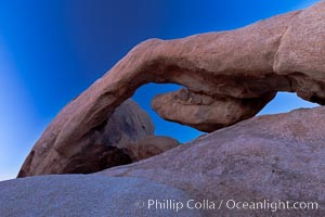Arch Rock, an ancient granite natural stone arch at Joshua Tree National park, at sunset, Joshua Tree National Park, California