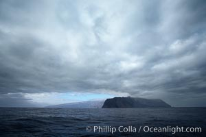 Guadalupe Island, dark and gloomy clouds, northern approach. Guadalupe Island (Isla Guadalupe), Baja California, Mexico, natural history stock photograph, photo id 21369