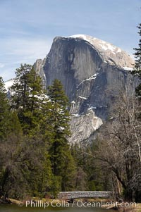 Half Dome rises above the Merced River and Sentinel Bridge.  Yosemite Valley, Yosemite National Park, California