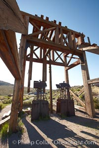 Image 23147, Head frame and machinery. Bodie State Historical Park, California, USA, Phillip Colla, all rights reserved worldwide. Keywords: arrested decay, bodie, bodie ghost town, bodie state historic park, bodie state historical park, bridgeport, california, eastern sierra, ghost town, gold mine, gold mining, gold rush, historic state park, mining camp, mining town, old west, outdoors, outside, sierra, state park, state parks, town, usa, village, west.