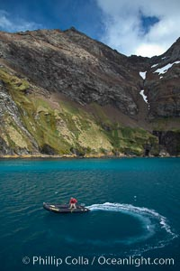 Zodiac motors through the blue-green waters of Hercules Bay. South Georgia Island, natural history stock photograph, photo id 24418
