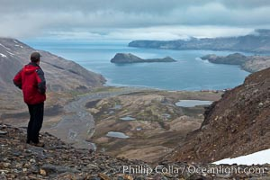 Hiker looks down on Stromness Harbour from the pass high above. Stromness Harbour, South Georgia Island, natural history stock photograph, photo id 24582
