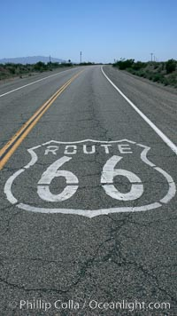 Route 66 (also known as U.S. Route 66, The Main Street of America, The Mother Road and the Will Rogers Highway) was a highway in the U.S. Highway system. One of the original federal routes, US 66 was established in 1926 and originally ran from Chicago through Missouri, Kansas, Oklahoma, Texas, New Mexico, Arizona, and California, before ending at Los Angeles for a total of 2,448 miles.  US 66 was officially decommissioned (i.e., removed from the offical U.S. Highway system) in 1985 after it was decided the route was no longer relevant and had been replaced by the Interstate Highway System. California, USA, natural history stock photograph, photo id 20593