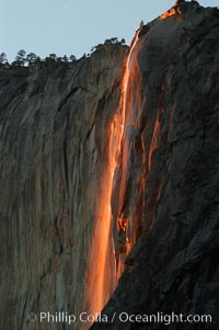 Image 06996, Horsetail Falls backlit by the setting sun as it cascades down the face of El Capitan, February, Yosemite Valley. Horsetail Falls, Yosemite National Park, California, USA, Phillip Colla, all rights reserved worldwide. Keywords: abstracts and patterns, california, cascade, el capitan, environment, flow, horsetail falls, landscape, mountain and peak, national parks, nature, outdoors, outside, scene, scenery, scenic, sierra, sierra nevada, sunset, usa, water, waterfall, world heritage sites, yosemite, yosemite national park, yosemite park, yosemite valley.
