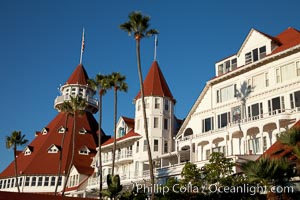 Hotel del Coronado, known affectionately as the Hotel Del. It was once the largest hotel in the world, and is one of the few remaining wooden Victorian beach resorts. It sits on the beach on Coronado Island, seen here with downtown San Diego in the distance. It is widely considered to be one of Americas most beautiful and classic hotels. Built in 1888, it was designated a National Historic Landmark in 1977. San Diego, California, USA, natural history stock photograph, photo id 27108