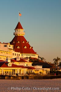 Image 27394, Hotel del Coronado, known affectionately as the Hotel Del. It was once the largest hotel in the world, and is one of the few remaining wooden Victorian beach resorts. It sits on the beach on Coronado Island, seen here with downtown San Diego in the distance. It is widely considered to be one of Americas most beautiful and classic hotels. Built in 1888, it was designated a National Historic Landmark in 1977. San Diego, California, USA, Phillip Colla, all rights reserved worldwide. Keywords: beach, california, city, coast, coronado, coronado island, del, downtown, historic, hotel, hotel del, hotel del coronado, inn, landmark, ocean, outdoors, outside, over, pacific, resort, san diego, scene, scenery, scenic, sea, seashore, shore, tourism, travel, urban, usa, view, vista.
