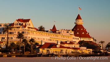 Hotel del Coronado, known affectionately as the Hotel Del. It was once the largest hotel in the world, and is one of the few remaining wooden Victorian beach resorts. It sits on the beach on Coronado Island, seen here with downtown San Diego in the distance. It is widely considered to be one of Americas most beautiful and classic hotels. Built in 1888, it was designated a National Historic Landmark in 1977. San Diego, California, USA, natural history stock photograph, photo id 27395