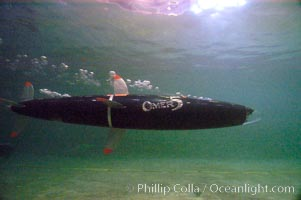 The OMER 5 human-powered submarine, designed, built and operated by Montreal, Canadas École de Technologie Supérieure (University of Quebec) engineering students.  The submersible is 16 feet long and has two people inside powering and piloting the sub.  Made of high tech composite materials and containing networked computers, the OMER 5 has reached a speed of nearly 7 knots underwater, a world record for human-powered submarines, Offshore Model Basin, Escondido, California