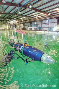 The OMER 5 human-powered submarine is raised from the Offshore Model Basin in Escondido California.  The sub was designed, built and operated by Montreal, Canadas École de Technologie Supérieure (University of Quebec) engineering students.  The submersible is 16 feet long and has two people inside powering and piloting the sub.  Made of high tech composite materials and containing networked computers, the OMER 5 has reached a speed of nearly 7 knots underwater, a world record for human-powered submarines