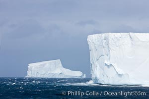 Iceberg (left) and tabular iceberg (right). Tabular icebergs can be dozens or hundreds of miles in size, have flat tops and sheer sides, Scotia Sea