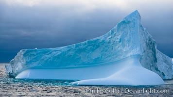 Iceberg, ocean, light and clouds.  Light plays over icebergs and the ocean near Coronation Island