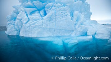 Iceberg above water and some of the underwater portion seen as well. Brown Bluff, Antarctic Peninsula, Antarctica, natural history stock photograph, photo id 24802